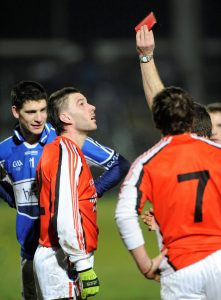 Brendan Quigley and Peadar Toal receive red cards from referee Pat Fox