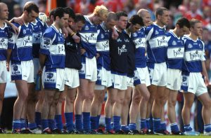 Members of the Laois squad stand for a minute silence before the start of the game