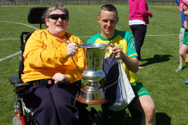 Lee pictured with supporter Sean Molloy after last season's league win