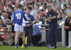 Mick O'Dwyer shakes hands with Ross Munnelly as he is substituted