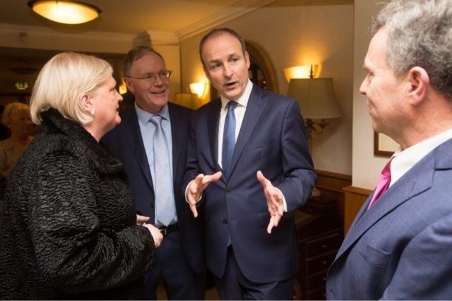 Fianna Fail leader Michael Martin chats to Sean Fleming at the party's dinner dance in the Castle Arms in Durrow