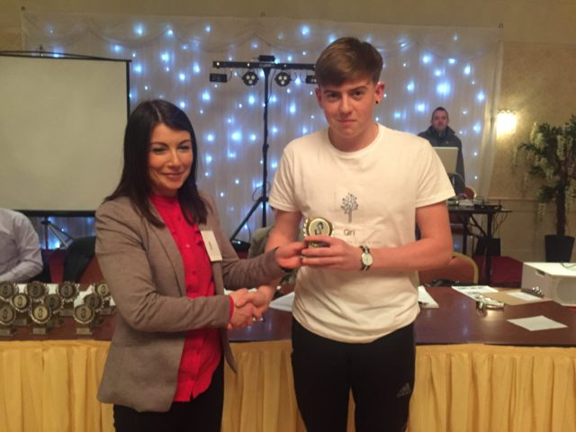 Shane Buggie of QRI winning third place in marketing at the PDST Get up and Go competition for TY Mini Company students in Kilkenny