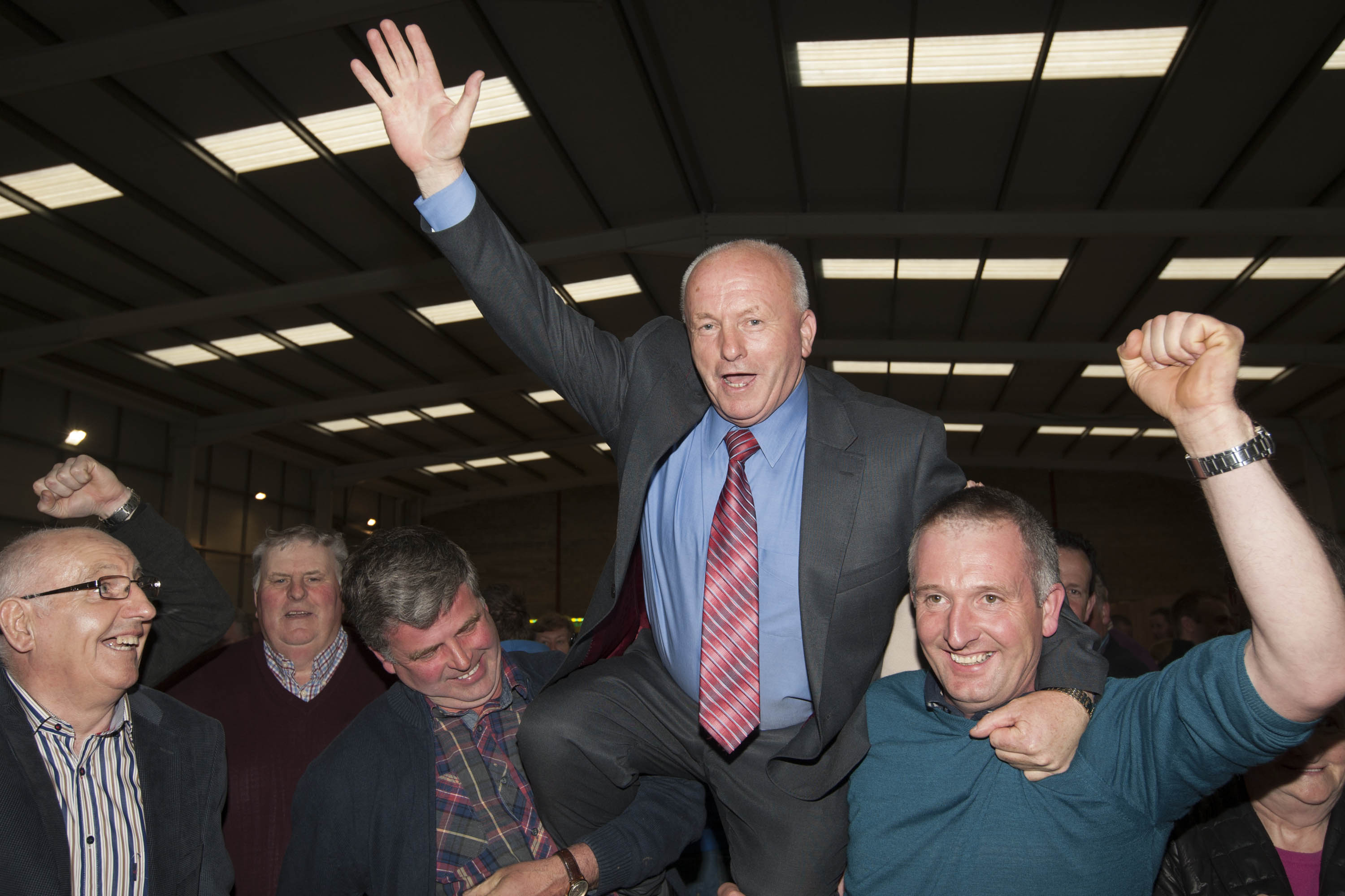 Celebrating his election at the 2014 count