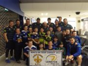 Members of the Portlaoise RFC team with members of Leinster Rugby squad