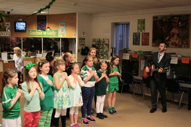 A group from Gaelscoil Phortlaoise with their teacher Muinteoir Dominic at a recent Irish night in Portlaoise library