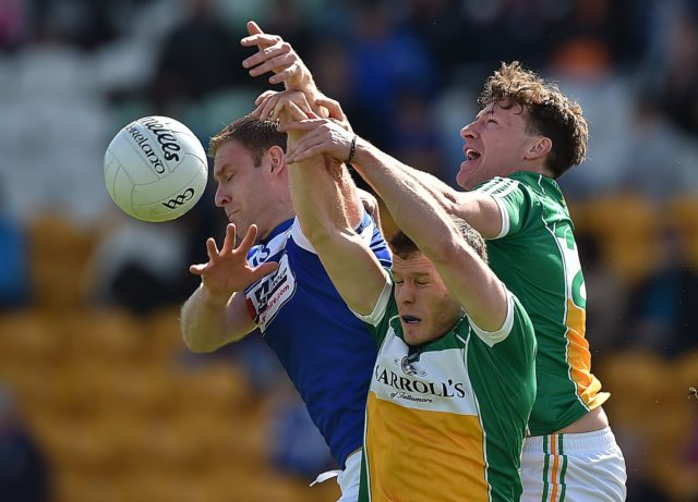 Donal Kingston in action against Shane Nally and James Lawlor in Laois's defeat