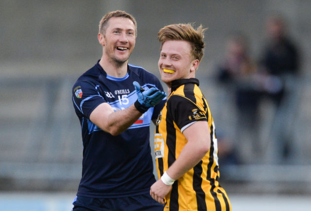 Billy Sheehan of St Jude's shares a joke with Jordan Briggs of Naomh Mearnóg during the Dublin County Senior Club Football Championship Round 1 match