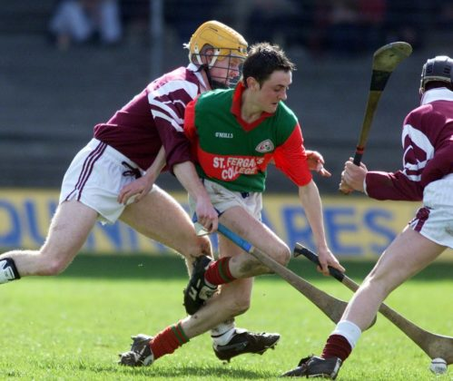 Philip Russell, St. Fergal's, Rathdowney controls this ball despite the St. Rynagh's C.S. efforts
