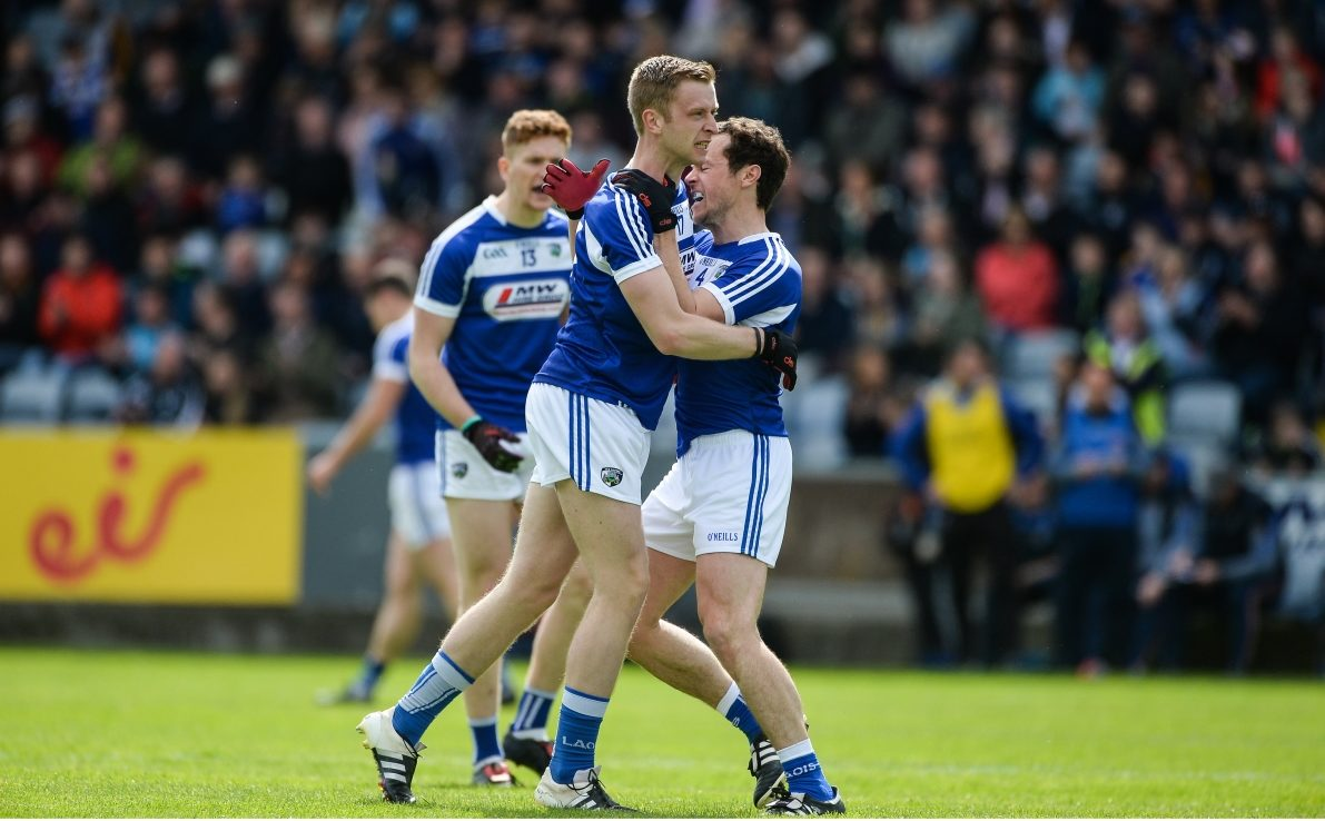 Paul Kingston celebrates with Pádraig McMahon after the first Laois goal