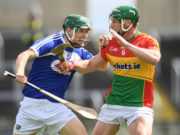 Sean Downey is tackled by David English of Carlow in todays game