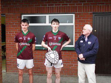 Portarlington joint captains Jordan Fallon and Eoin Kennedy with Laois GAA Chairman Gerry Kavanagh