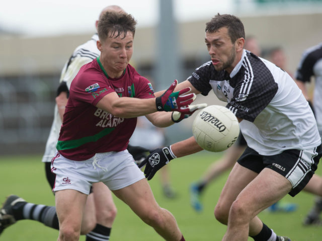 Jake Foster gets this pass away for Portarlington against Niall O'Rourke, Arles Killeen in the SFC at O'More Park. Picture: Alf Harvey/HRPhoto.ie