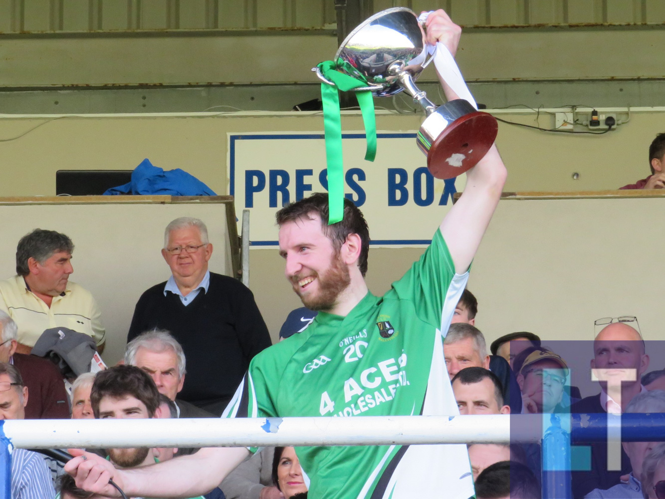 Ricky Quillinan lifts the cup as Ballyfin Gaels are crowned champions