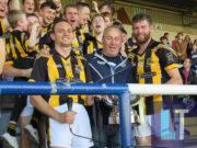 Joe Phelan and Zane Keenan receive the Bob O'Keeffe Cup from Seamus Mortimer