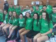 Nicole Turner, front, and Seán Scannell, back, with the rest of the Swim Ireland team at the UK Schools Swimming Championships