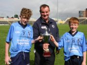 Ballyroan-Abbey joint captains Shaun Fitzpatrick and Michael O'Connor receive the U-14 cup from Brian Allen. Pic: Dave Maher