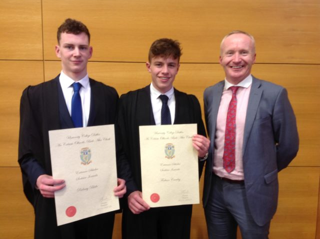 Padraig Burke and Emo's Finbarr Crowley who were presented with the UCD awards. Pictured with teacher Gerry Grealish
