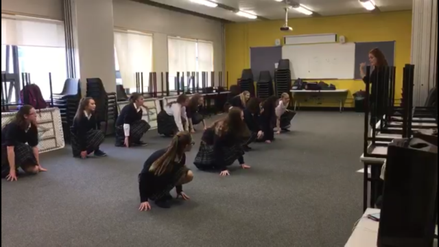 A shot of the Scoil Chriost Ri TY girls who are practicing for their for their musical
