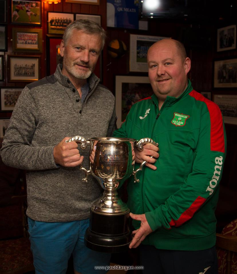 Declan O'Loughlin handing over the Barney Hennessy Cup to Graiguecullen chairman Michael Lawler