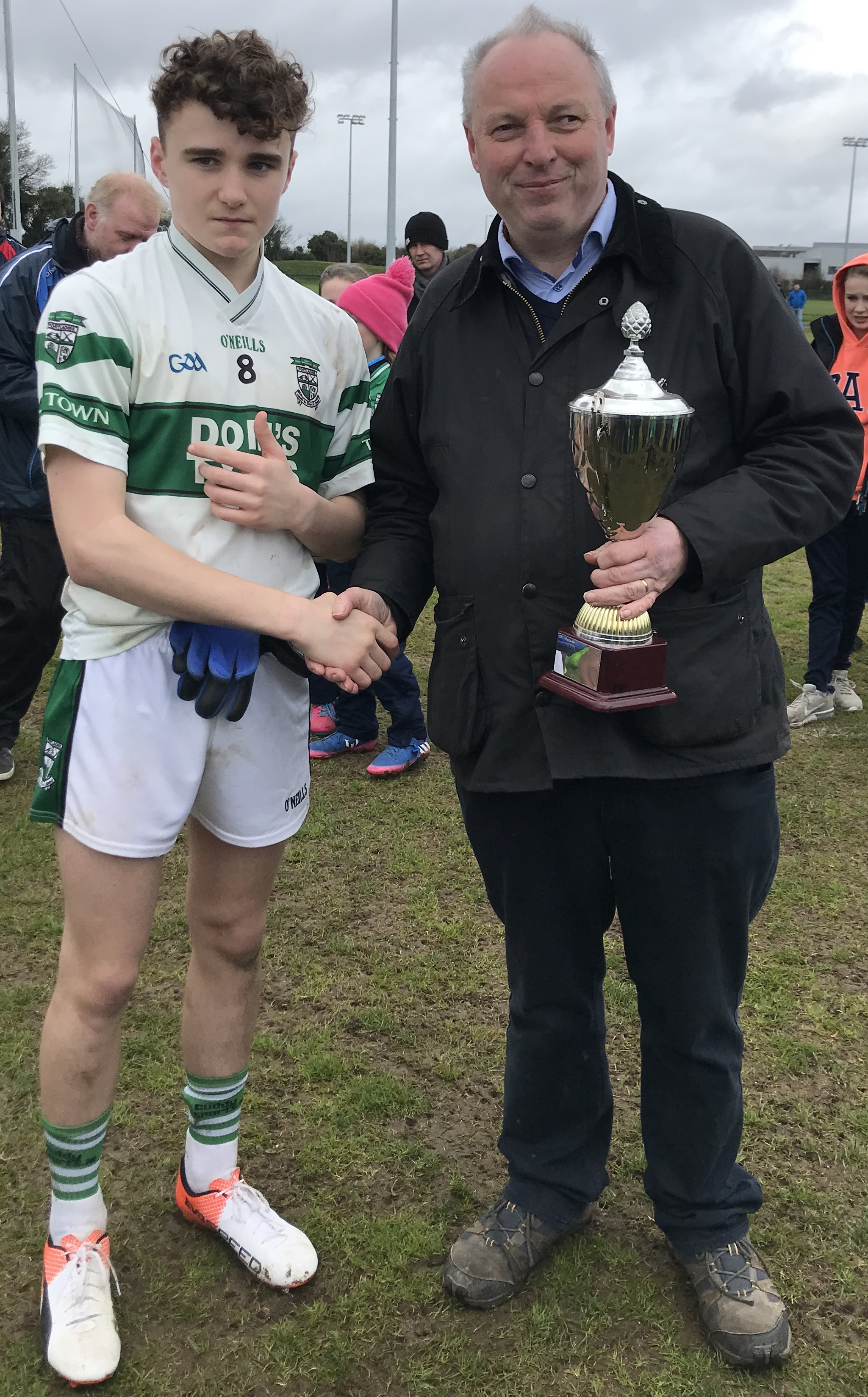 Portlaoise captain Barry Fitzpatrick receives the cup from Sean Connolly