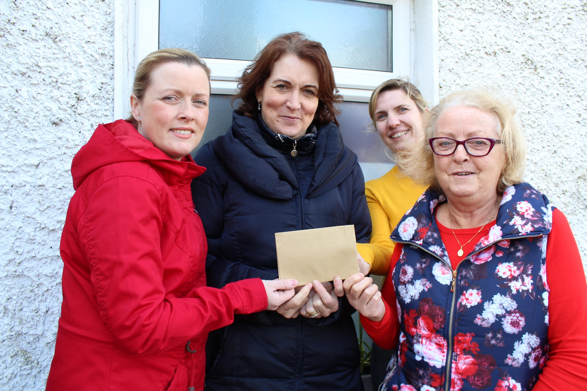 Janice and Mary Carthy present a cheque for €1000 for Naíscoil Kantara to Timahoe NS principal Ann Bergin and teacher Orla Mulhare.