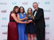 Evelyn O'Rourke (left) and Sean O'Rourke (right) present Colette Byrne and her daughter, Kate, with the Everyday Hero Award